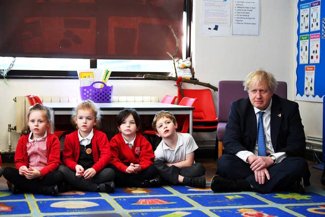 Before his Brexit event Boris Johnson visited a school to promote International Women's Day (Dylan Martinez/PA)