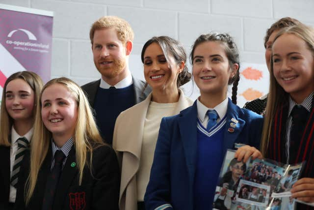 Harry and Meghan Markle with school children in Lisburn (Niall Carson/PA)