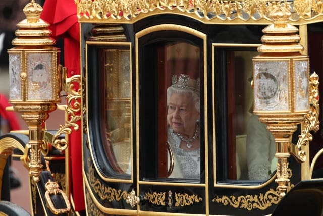 The Queen travels in the Diamond Jubilee State Coach