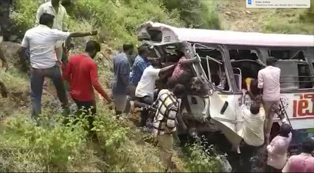 Rescuers pull passengers from the bus