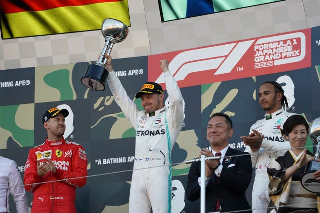 Mercedes driver Valtteri Bottas celebrates winning the Japanese Grand Prix