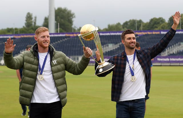 Ben Stokes (left) and Mark Wood celebrate with Cricket World Cup in Durham