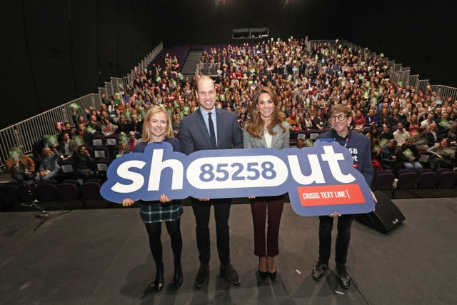 William and Kate on a London theatre stage during a volunteer celebration event with the text helpline Shout. Yui Mok/PA