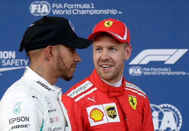 Lewis Hamilton, left, was unimpressed by Sebastian Vettel's driving under the safety car