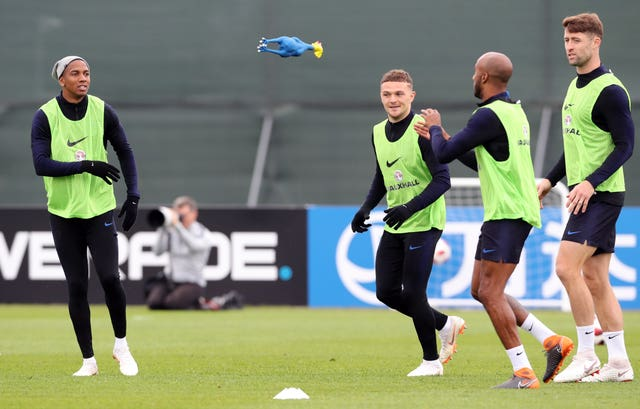England players play with a rubber chicken during the training session at the Spartak Zelenogorsk Stadium