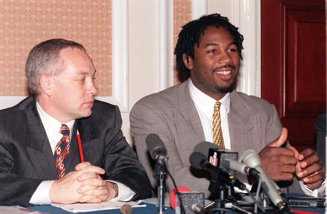 Kellie Maloney before her transition, as Frank, with Lennox Lewis