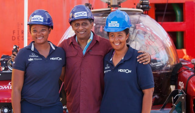 Seychelles President Danny Faure with scientists ahead of the dive