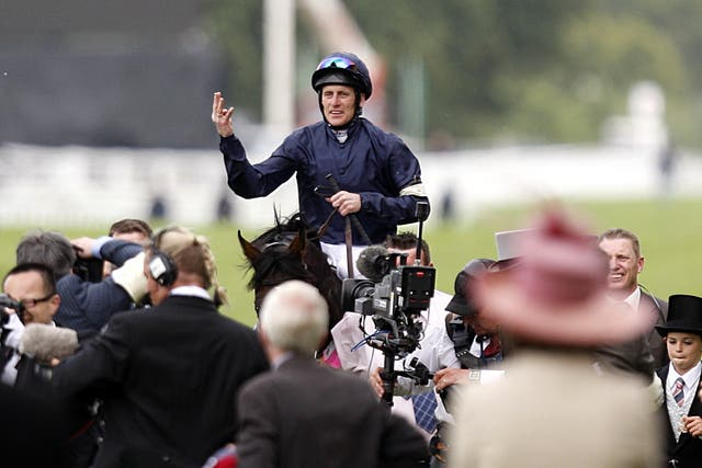 Johnny Murtagh salutes the crowd after Yeats wins his fourth Gold Cup