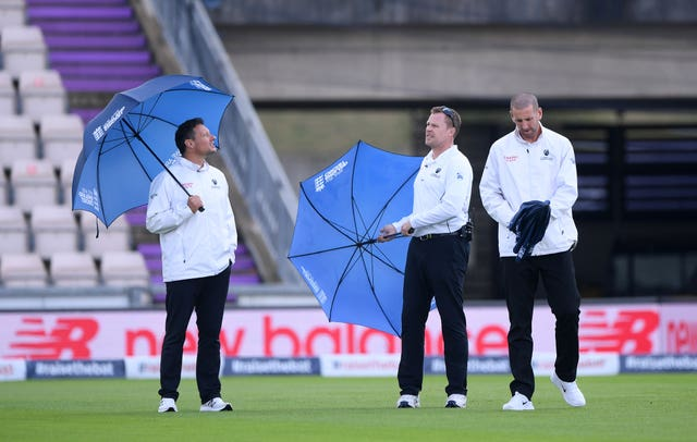 Umpires Richard Kettleborough, Martin Saggers and Michael Gough (left-right) inspect the pitch on day five of the second Test