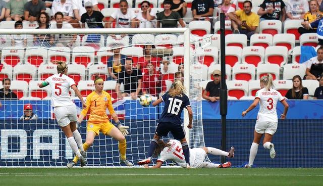 Claire Emslie, centre, scores Scotland's goal against England