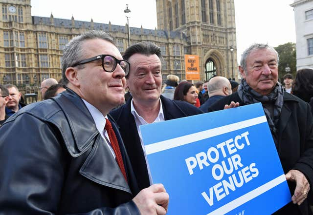 (Left to right) Labour's deputy leader Tom Watson, Feargal Sharkey and Pink Floyd's Nick Mason join a gathering outside the Houses of Parliament in London calling for a change in the law to protect live venues across the UK (Stefan Rousseau/PA)