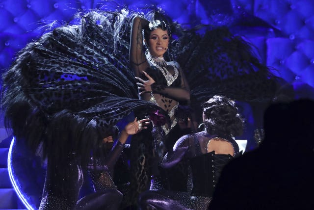 Cardi B performs her hit Money at the Grammy Awards