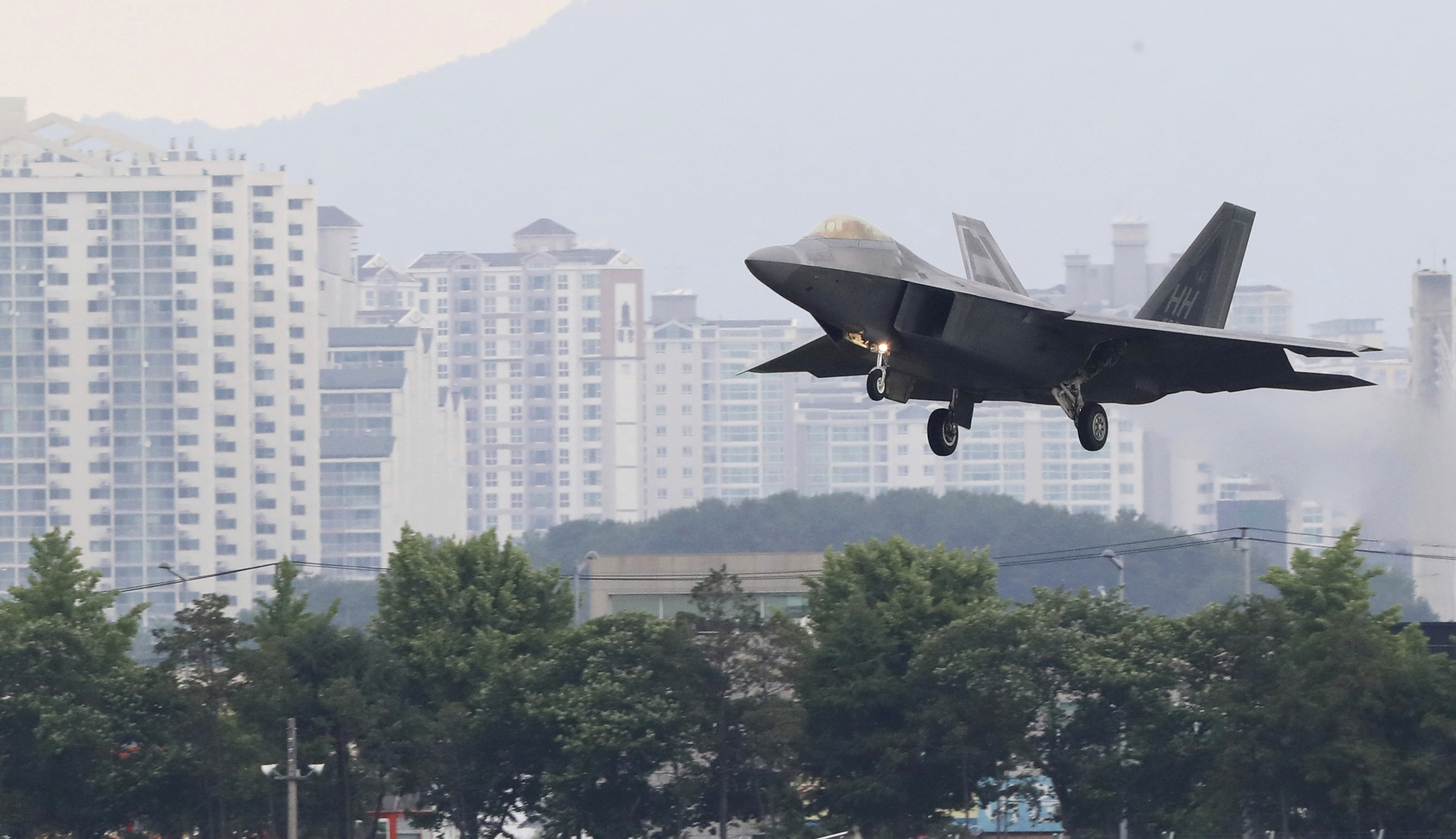 A U.S. F-22 Raptor stealth fighter jet lands as South Korea and the United States conduct the Max Thunder joint military exercise at an air base in Gwangju South Korea