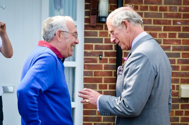 The Prince of Wales meets Richard Kerslake during a visit to the Mildren Homes development on Duchy of Cornwall land in Fordington, Dorset. Ben Birchall/PA Wire