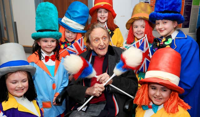 Sir Ken Dodd, surrounded by Diddy Men, leaving hospital (Peter Byrne/PA)