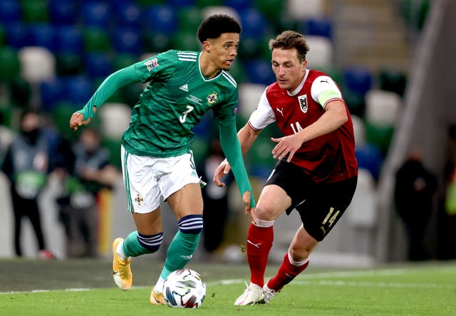 Northern Ireland's Jamal Lewis and Austria's captain Julian Baumgartlinger battled for the ball as Austria won 1-0