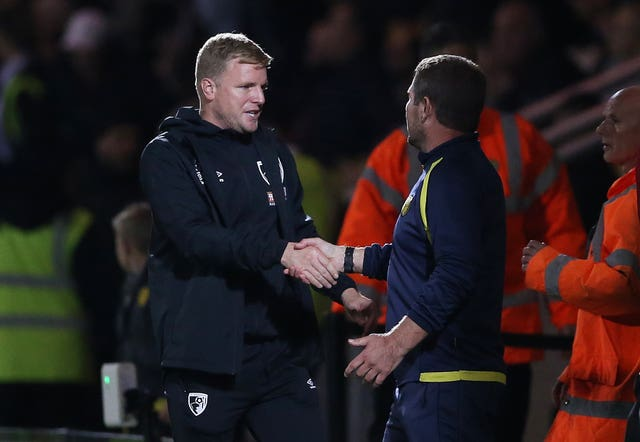 Bournemouth manager Eddie Howe shakes hands with Burton boss Nigel Clough