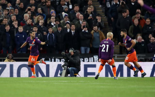 Riyad Mahrez celebrates scoring against Tottenham