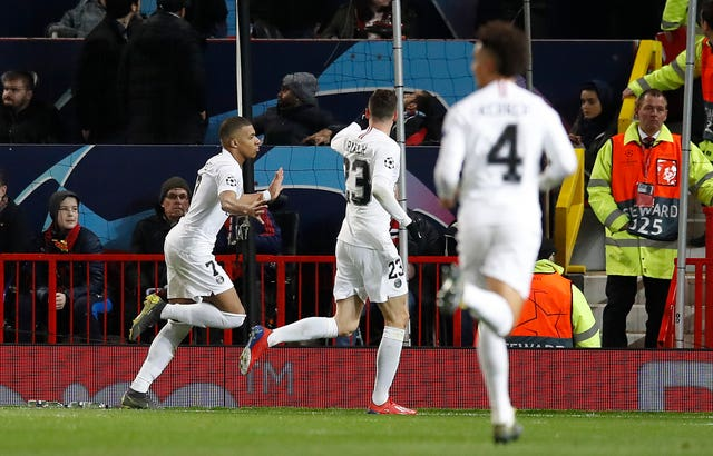 Kylian Mbappe celebrates scoring against Manchester United in the Champions League