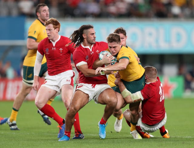 Josh Navidi, pictured tackling Australia's James O'Connor, has been ruled out of the rest of the World Cup by injury and has been replaced by Owen Lane.