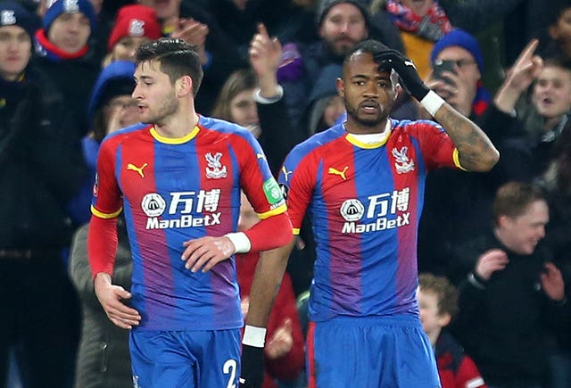 Jordan Ayew, right, reacts after scoring Palace's winner against Grimsby