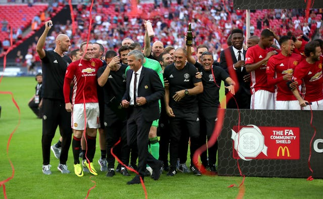 Mourinho celebrates with his players after beating Leicester to win the Community Shield at Wembley in August 2016