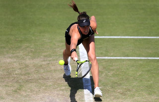 Johanna Konta stretches to try to retrieve a shot during her win over Heather Watson
