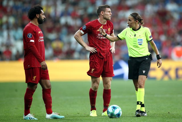 Frappart with Liverpool's Mohamed Salah and James Milner