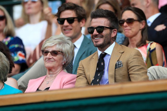David Beckham, right, was at Centre Court to watch Serena Williams