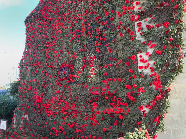 Knitted poppies adorn Sudbury church