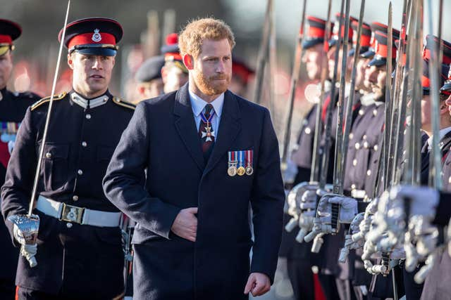 Prince Harry inspects the graduating officer cadets at the Royal Military Academy in Sandhurst in December 2017 (Richard Pohle/The Times/PA)