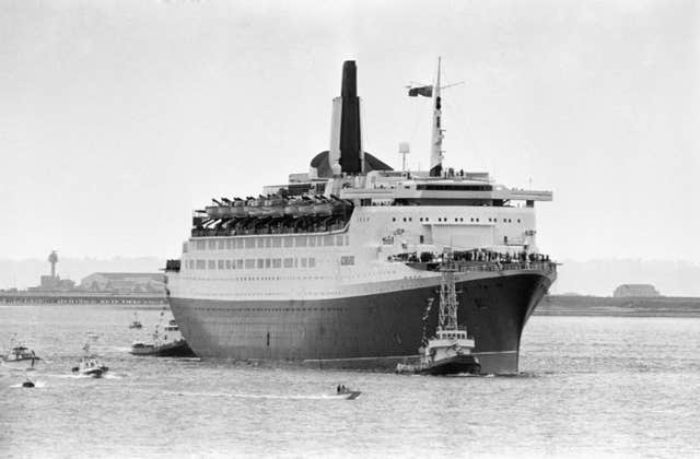 The QE2 coming into dock at Southampton after her voyage from the Falklands (PA)