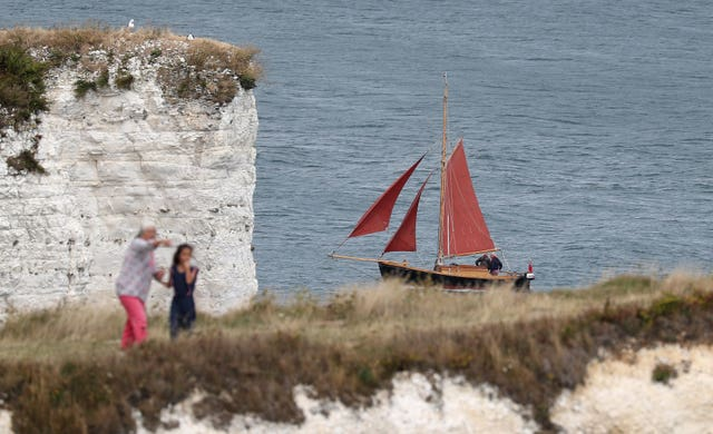 A sailing boat makes its way past Old Harry Rocks (Andrew Matthews/PA)