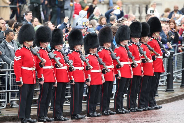Soldiers from Nijmegen Company, Grenadier Guards, line the processional route on The Mall