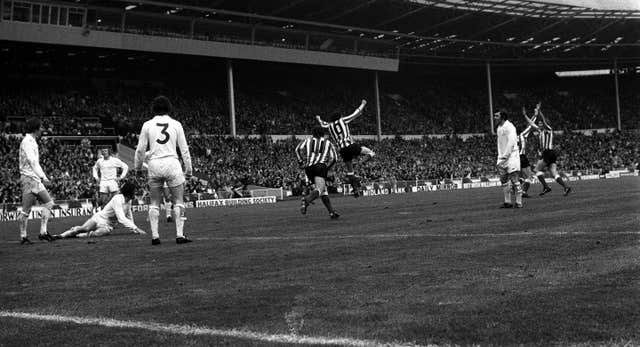 Leeds players, including Trevor Cherry (number three) watch Ian Portersfield score the only goal in the 1973 FA Cup final