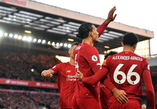 Virgil Van Dijk celebrates scoring his second