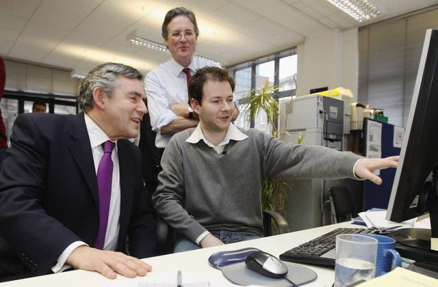 Gordon Brown sending a tweet on a visit to the Disasters Emergency Committee