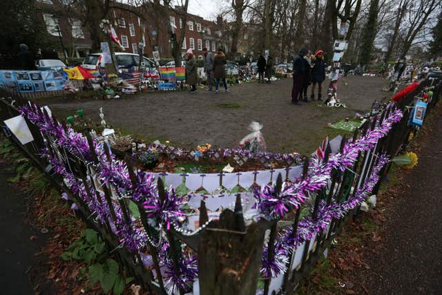 Tributes are left opposite the home of singer George Michael in The Grove, Highgate, London (Jonathan Brady/PA)