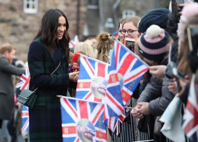 Meghan Markle meets crowds of well-wishers during a walkabout on the esplanade at Edinburgh Castle