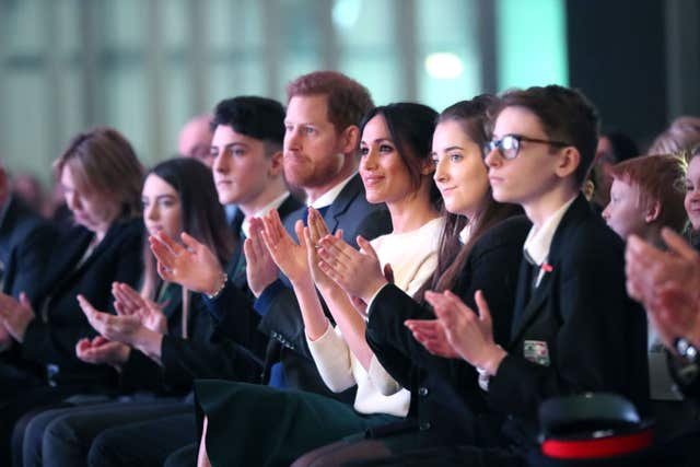 Harry and Ms Markle attended an event to mark youth-led peace-building initiative Amazing the Space (Niall Carson/PA)