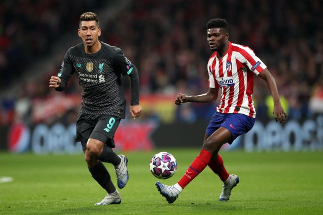 Thomas Partey (right) has been linked with a move to Arsenal from Atletico Madrid.