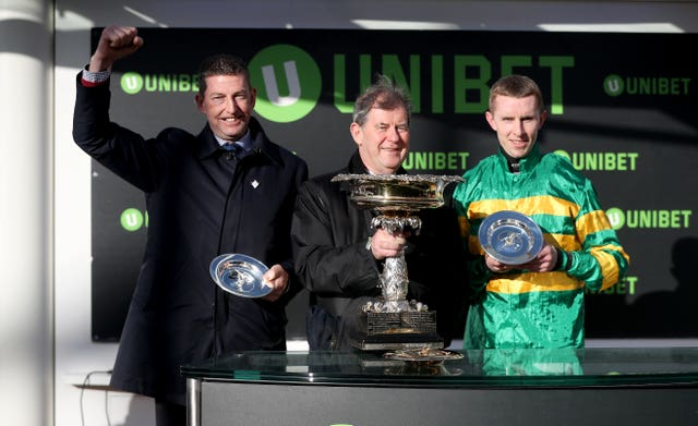 Trainer Gavin Cromwell (left), owner JPMcManus and jockey Mark Walsh after Espoir D'Allen's Champion Hurdle win
