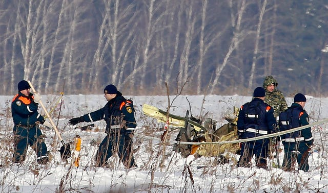 The grim search for bodies continues (AP)