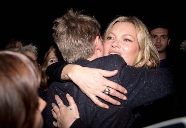 Bailey hugs Kate Moss after his last Burberry show (Isabel Infantes/PA)