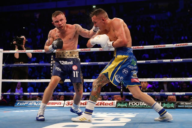 Carl Frampton, left, lost to Josh Warrington last December (Martin Rickett/PA)
