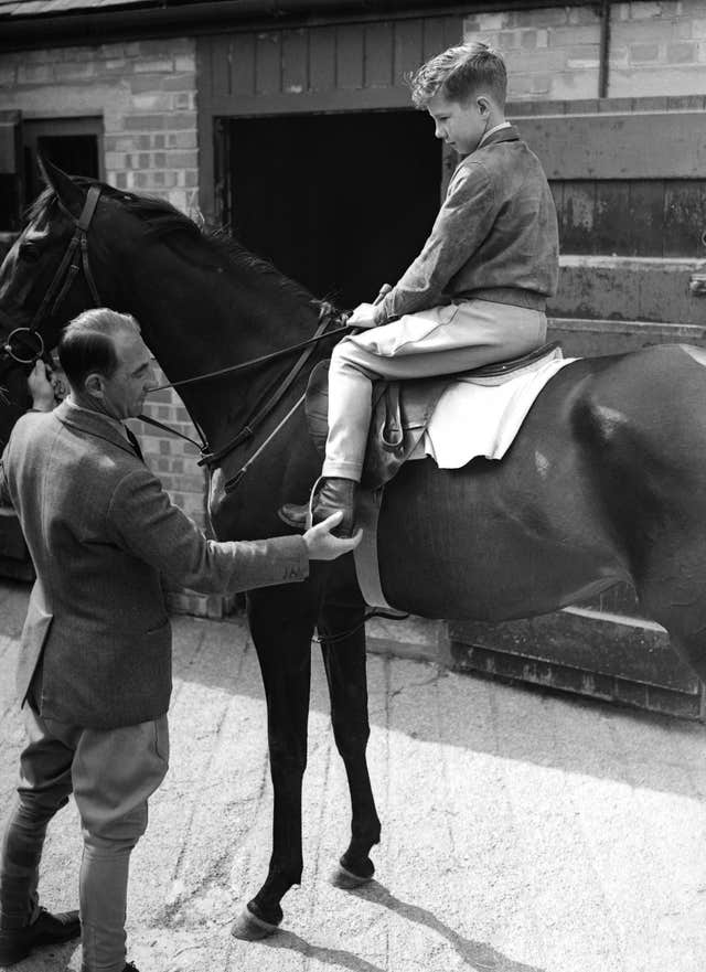 Lester Piggott, age 12, sitting on a horse at his fathers stables at Lambourn