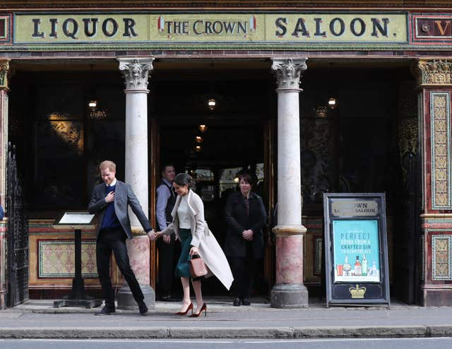 Harry and Meghan leaving the Crown Liquor Saloon where they sat down to a traditional Irish pub lunch (Gareth Fuller/PA)