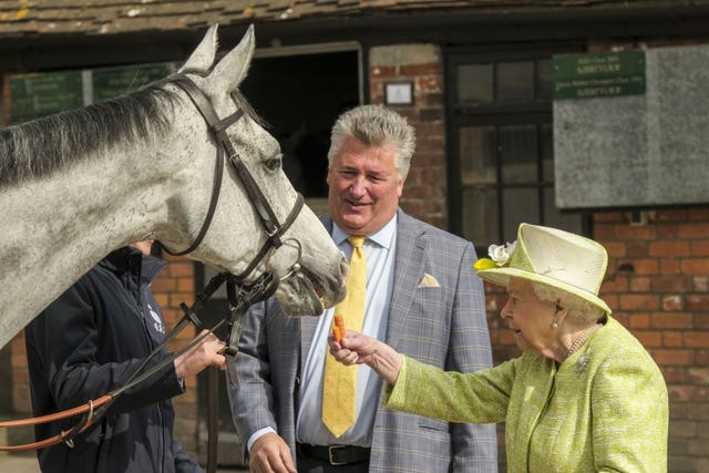 Paul Nicholls with the Queen at a recent stable visit
