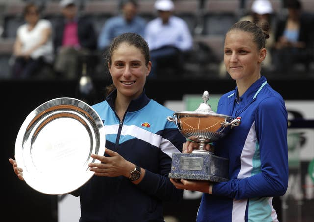 Johanna Konta, left, holds her runner-up trophy after losing to Karolina Pliskova in the Rome final
