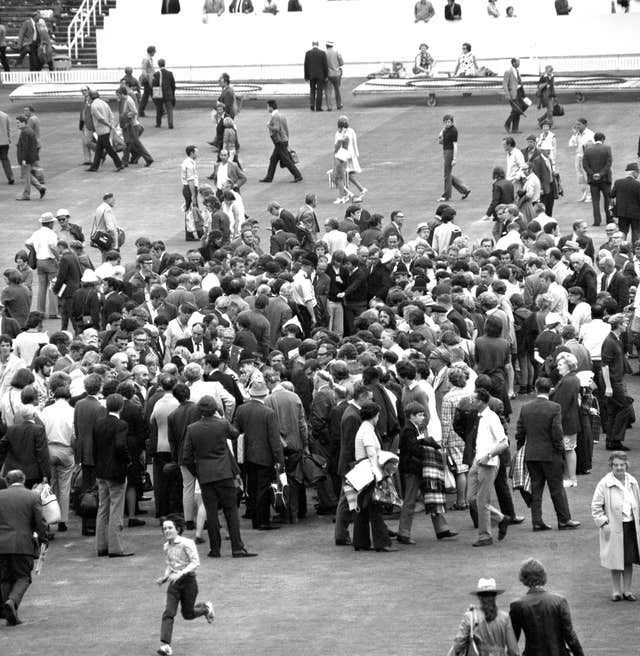 Fans inspect the Headingley wicket after England took a 2-1 lead in the 1972 Ashes series with a nine-wicket win. The series would finish in a draw